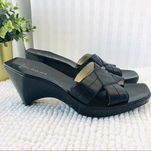 BCBGMAXARIA mules black leather crisscross slip on